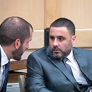 AUGUST 13, 2018---FORT LAUDERDALE, FLORIDA--<br /> Pablo Ibar talks to one of his lawyers, Joe Nascimento,  as he sits in a courtroom in the Broward County Courthouse at the beginning of a hearing to schedule his new trial. Ibar has been in jail  for 24 years accused of the murders of a bar owner and two models in his house following a home invasion.<br /> (Photo by Angel Valentin)