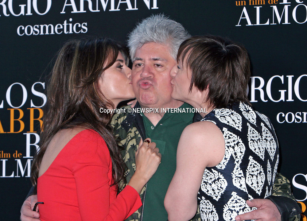 "PENELOPE CRUZ AND PEDRO ALMODOVAR.Pedro looks startled when kissed by gorgeous Penelope. But with his looks that miust have been a godsend..They were at the presentation of  Los Abrazos Rotos in Madrid_13/03/2009.Mandatory Credit Photo: ©NEWSPIX INTERNATIONAL..**ALL FEES PAYABLE TO: ""NEWSPIX INTERNATIONAL""**..IMMEDIATE CONFIRMATION OF USAGE REQUIRED:.Newspix International, 31 Chinnery Hill, Bishop's Stortford, ENGLAND CM23 3PS.Tel:+441279 324672  ; Fax: +441279656877.Mobile:  07775681153.e-mail: info@newspixinternational.co.uk"