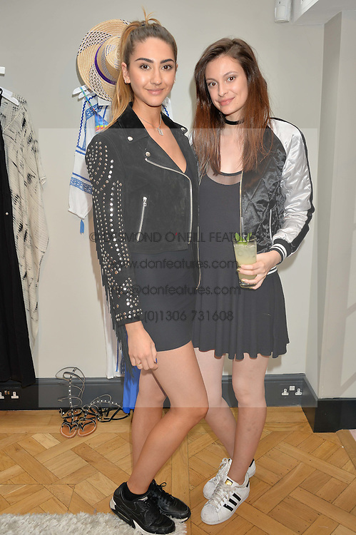 Left to right, AMBER DONOSO and LUCY RABORN at the launch of the new Salt store at 91 Walton Street, London on 7th July 2016.