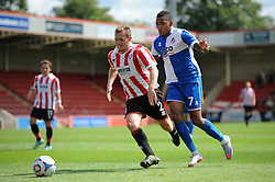 Christian Montano of Bristol Rovers chases down Jack Barthram of Cheltenham Town - Mandatory by-line: Dougie Allward/JMP - 25/07/2015 - SPORT - FOOTBALL - Cheltenham Town,England - Whaddon Road - Cheltenham Town v Bristol Rovers - Pre-Season Friendly