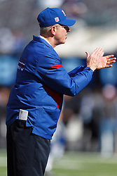 Oct 16, 2011; East Rutherford, NJ, USA; New York Giants head coach Tom Coughlin applauds his team during warm ups before the game against the Buffalo Bills at MetLife Stadium. Mandatory Credit: Jason O. Watson-US PRESSWIRE