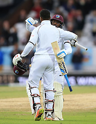 West Indies Shai Hope is congratulated by Jermaine Blackwood (facing) on reaching his century during day five of the the second Investec Test match at Headingley, Leeds.