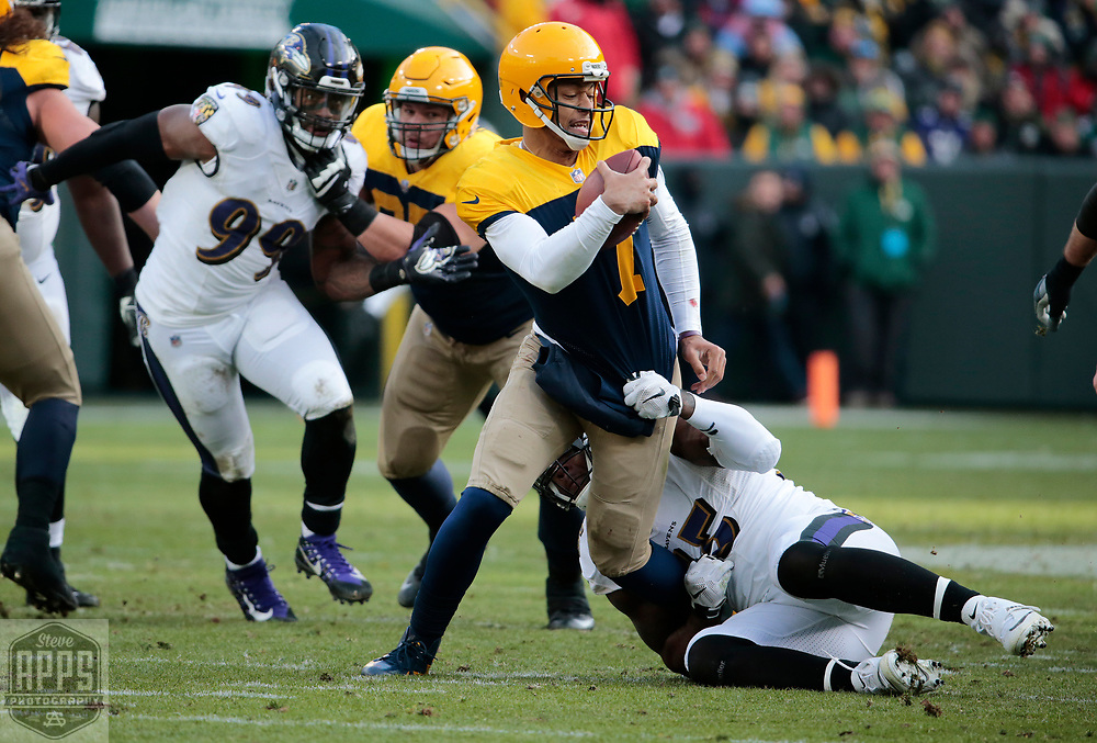 Baltimore Ravens outside linebacker Terrell Suggs (55) sacked Green Bay Packers quarterback Brett Hundley (7) for an 12-yard loss on 4th and 11-yards late in the 4th quarter. <br /> The Green Bay Packers hosted the Baltimore Ravens at Lambeau Field Sunday, Nov. 19, 2017. The Packers lost 23-0. STEVE APPS FOR THE STATE JOURNAL.