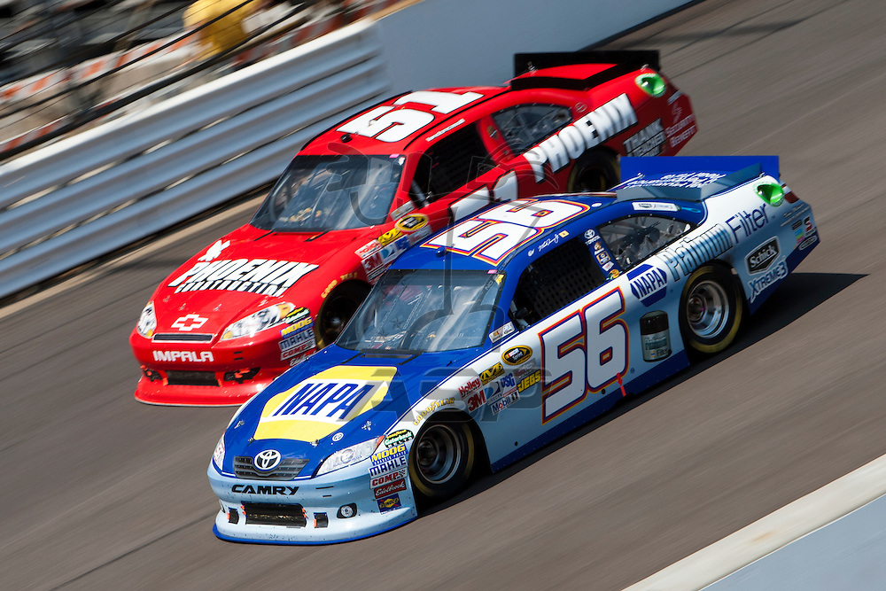 Speedway, IN  - JUL 31, 2011:  Martin Truex, Jr. (56) races to turn one for the Brickyard 400 presented by BigMachineRecords.com at Indianapolis Motor Speedway in Speedway, IN.