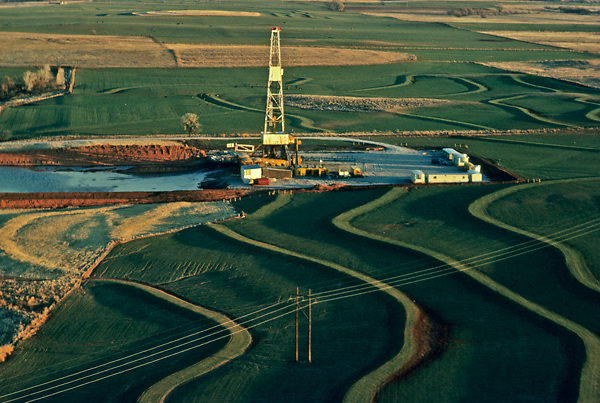 Stock photo of the aerial view of an on-shore rig