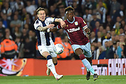 Aston Villa striker(on loan from Chelsea) Tammy Abraham (18) battles for possession  with West Bromwich Albion midfielder (on loan from Fulham) Stefan Johansen (6) during the EFL Sky Bet Championship play-off second leg match between West Bromwich Albion and Aston Villa at The Hawthorns, West Bromwich, England on 14 May 2019.