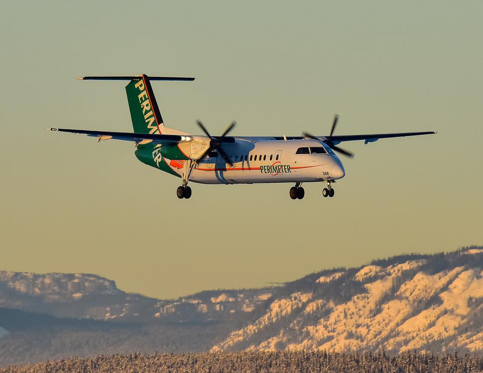 A Perimeter Aviation de havilland Dash 8-300 on final approach into Erik Nielsen Whitehorse International Airport
