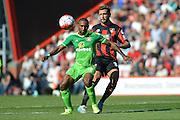 Sunderland AFC striker Jermain Defoe shields the ball from AFC Bournemouth's defender Steve Cook during the Barclays Premier League match between Bournemouth and Sunderland at the Goldsands Stadium, Bournemouth, England on 19 September 2015. Photo by Mark Davies.