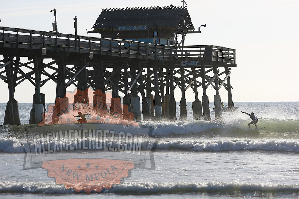 Two surfers compete during the 28th annual National Kidney Foundation, Rich Salick Pro/Am surf festival takes place at the the Cocoa Beach pier on Saturday,  September 2, 2013 in Cocoa Beach, Florida. This event raises thousands of dollars for people with kidney disease and also benefits the services of the NKF of Florida. (AP Photo/Alex Menendez)