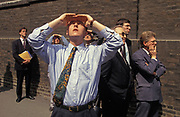 City workers look at the damage to buildings caused by the IRA Bishopsgate bomb in the City of London, on 26th April 1993, in London, England. Two days after the Irish Republican Army (IRA) exploded a truck bomb on Bishopsgate, a main arterial road that travels north-south through London's financial area, City of London three on-lookers stop to view damage to the tall HSBC building. It was said that Roman remains could be viewed at the bottom of the pit the bomb created. One person was killed when the one ton fertiliser bomb detonated directly outside the medieval St Ethelburga's church. Buildings up to 500 metres away were damaged, with one and a half million square feet (140,000 m) of office space being affected and over 500 tonnes of glass broken. repair costs reached approx £350 million.