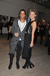 OLLIE LOCKE and AMBER ATHERTON at a private view of Fly to Baku - Contemporary Art from Azerbaijan held at Phillips de Pury, Howick Place, London SW1 on 17th January 2012.