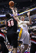 March 13, 2012; Indianapolis, IN, USA; Indiana Pacers power forward Tyler Hansbrough (50) shoots the ball as Portland Trail Blazers center Kurt Thomas (40) defends at Bankers Life Fieldhouse. Indiana defeated Portland 92-75. Mandatory credit: Michael Hickey-US PRESSWIRE