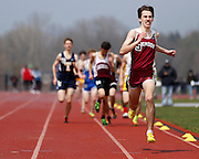 Kevin Dooley of Pittsford Mendon leads the third heat of the boys 800-meter run at the His and Her track and field invitational at Penfield High School on Saturday, April 26, 2014.