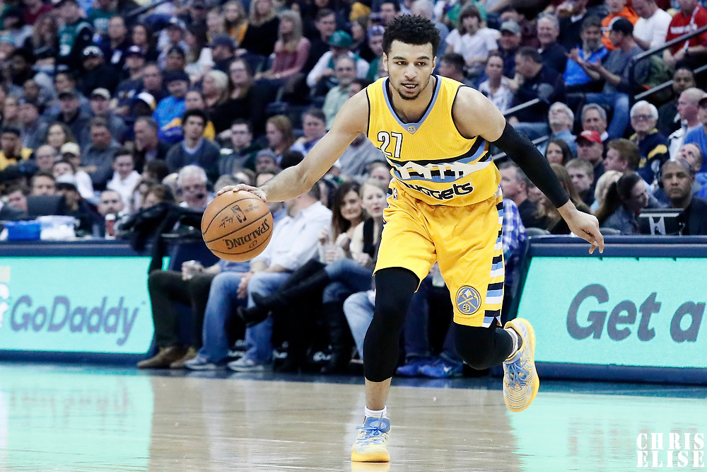 10 March 2017: Denver Nuggets guard Jamal Murray (27) dribbles during the Denver Nuggets 119-99 victory over the Boston Celtics, at the Pepsi Center, Denver, Colorado, USA.