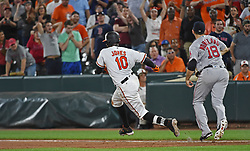 September 19, 2017 - Baltimore, MD, USA - The Baltimore Orioles' Adam Jones (10) runs to second base after an errant throw got past Boston Red Sox first baseman Mitch Moreland, right, in the 11th inning at Oriole Park at Camden Yards in Baltimore on Tuesday, Sept. 19, 2017. The Red Sox won, 1-0, in 11 innings. (Credit Image: © Kenneth K. Lam/TNS via ZUMA Wire)