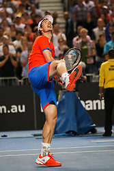 © Licensed to London News Pictures. 21/01/2012. Melbourne Park, Australia. Andy Murray (GBR) punches the air in celebration after winning in his men's singles match against Michael Llodra (FRA) during the 6th day, round 3 of the Australian Open. Photo credit : Asanka Brendon Ratnayake/LNP