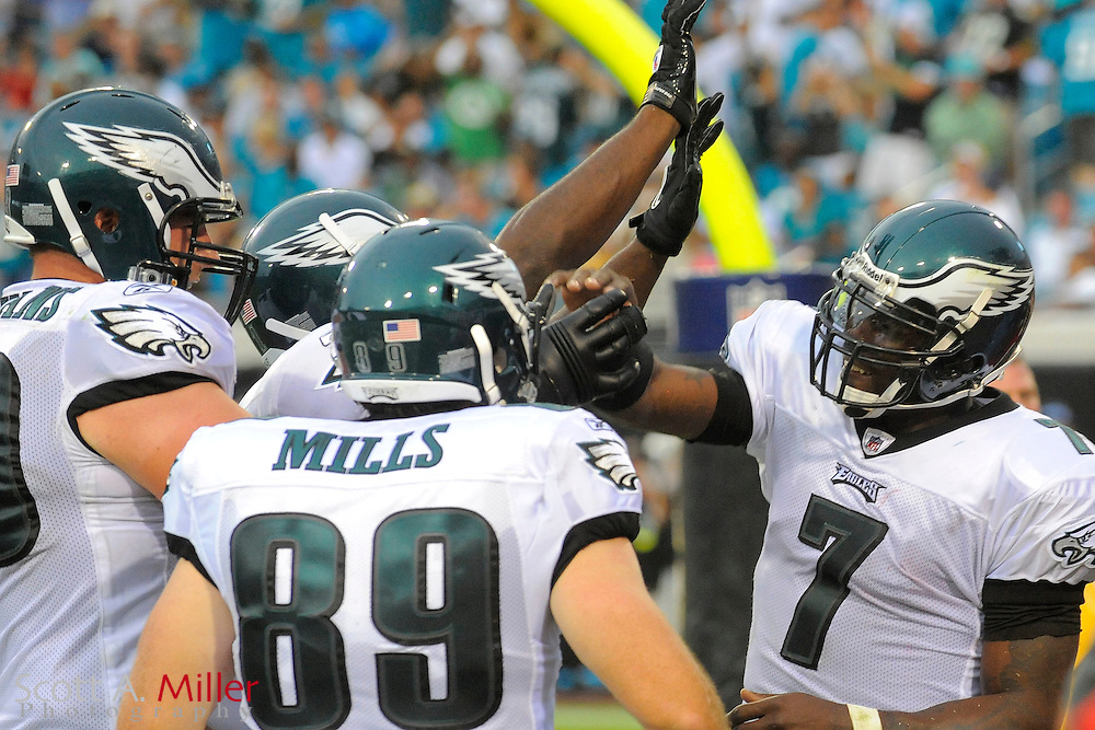 Sept. 26, 2010; Jacksonville, FL, USA; Philadelphia Eagles quarterback Michael Vick (7) celebrates his a second-half touchdown run during his team's game against the Jacksonville Jaguars at EverBank Field. ©2010 Scott A. Miller