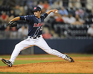 Mississippi's Jordan Cooper pitches vs. Auburn during a college baseball in Oxford, Miss. on Friday, May 21, 2010. (AP Photo/Oxford Eagle, Bruce Newman)