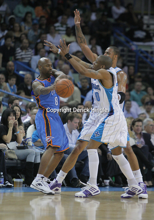07 March 2009: Oklahoma City Thunder guard Chucky Atkins (8) passes away from New Orleans Hornets defenders Antonio Daniels (50) and Tyson Chandler (6) during a 108-90 win by the New Orleans Hornets over the Oklahoma City Thunder at the New Orleans Arena in New Orleans, Louisiana.