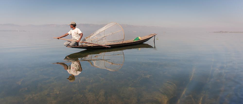 Fisherman on his boat in Inle Lake (Myanmar)