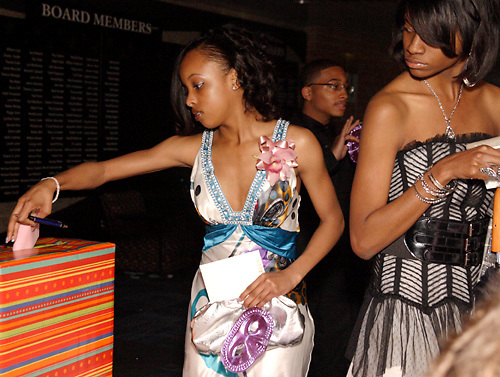 Senior Jasmine Ross (right) looks on as senior Brenlee Thornton votes for prom king and queen during the Trotwood-Madison High School prom at the Miami Valley Career Technology Center in Clayton, Saturday, May 8, 2010.