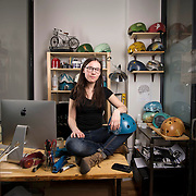 """February 24, 2014 - New York, NY : <br /> Danielle Baskin, founder of Belle Helmets, poses for a portrait in her office/studio space at 115 E. 23rd Street in Manhattan on Monday afternoon, Feb. 24. Danielle hand-paints bicycle helmets, which she sells to clients in New York and across the globe. Her setup includes a 21.5"""" iMac, visible at left, and an iPhone 5S, in foreground at center in an OtterBox case.  <br /> CREDIT: Karsten Moran for Macworld Magazine"""