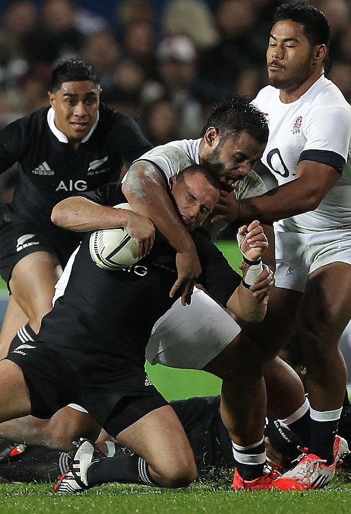 England's Billy Vunipola  receives a yellow card for this tackle on New Zealand's Aaron Cruden in an International Rugby Test match, Waikato Stadium, Hamilton, New Zealand, Saturday, June 21, 2014.  Credit:SNPA / David Rowland