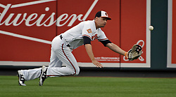 August 28, 2017 - Baltimore, MD, USA - Baltimore Orioles' Trey Mancini makes a diving catch on a line drive by the Mariners' Robinson Cano in the first inning Monday, Aug. 28, 2017 at Oriole Park at Camden Yards in Baltimore, Md. (Credit Image: © Kenneth K. Lam/TNS via ZUMA Wire)