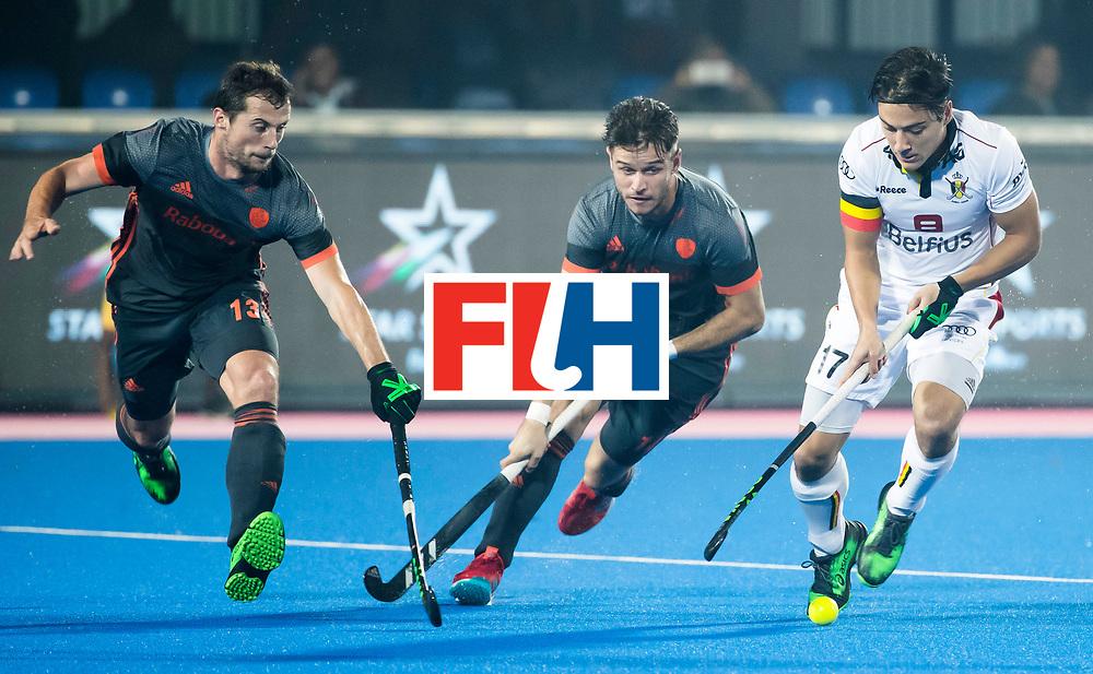 BHUBANESWAR - Sander Baart (Ned) (l)  en Robbert Kemperman (Ned) proberen Thomas Briels (Bel)  te stoppen  tijdens de Hockey World League Final wedstrijd Belgie-Nederland (3-0).   COPYRIGHT KOEN SUYK