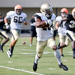 Aug 3, 2013; Metairie, LA, USA; New Orleans Saints wide receiver Saalim Hakim (18) returns a kickoff during a scrimmage at the team training facility. Mandatory Credit: Derick E. Hingle-USA TODAY Sports