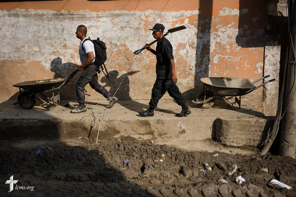 Workers clear mud from a street near Lima, Peru, on Tuesday, April 7, 2015. Heavy rains in March caused massive avalanches of mud and rocks in several regions, killing residents, displacing others, and causing infrastructure destruction. LCMS Communications/Erik M. Lunsford