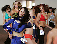 Kaoruko Horiike of Tokyo, Japan (L) performs a routine with other prospective Denver Broncos cheerleaders at the finals in Denver, Colorado April 1, 2007.  Over 250 women applied for the 34 slots awarded with Horiike making the team.  REUTERS/Rick Wilking (UNITED STATES)