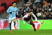 Calum Chambers (21) of Arsenal heads the ball back towards his goalkeeper as Leroy Sane (19) of Manchester City bears down on him during the EFL Cup Final match between Arsenal and Manchester City at Wembley Stadium, London, England on 25 February 2018. Picture by Graham Hunt.