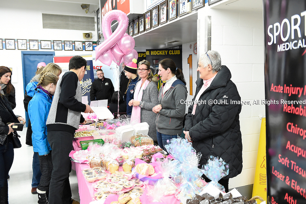 TORONTO, ON - Nov 29, 2014 : Ontario Junior Hockey League game action between Cobourg and Toronto Lakeshore, Toronto Patriots Pink in the Rink supporters out front before the game.<br /> (Photo by Andy Corneau / OJHL Images)