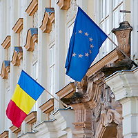 TIMISOARA, ROMANIA - APRIL 21:  An European and Romanian flags are seen on a wall in the city centre on April 21, 2013 in Timisoara, Romania.  Romania has abandoned a target deadline of 2015 to switch to the single European currency and will now submit to the European Commission a programme on progress towards the adoption of the Euro, which for the first time will not have a target date. (Photo by Marco Secchi/Getty Images)