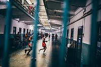 Inmates exercise outside of their cells at Klong Prem prison in Bangkok, Thailand. The inmates are part of a program that pits prisoners against foreign Muay Thai fighters for a chance of reduced sentencing or early release.