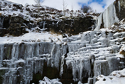 © Licensed to London News Pictures. 02/02/2019. Storey Arms, UK. A waterfall frozen over in the extreme cold temperatures in Storey Arms, Brecon Beacons, South Wales. Large parts of the UK continue to be deluged with snow and freezing temperatures. Photo credit: Andrew Bartlett/LNP