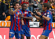 FC Basel midfielder Valentin Stocker (L-R) is being celebrated by Jacques Zoua Daogari and Benjamin Huggel after scoring to the score of 0-1 during the Super League (National League A) soccer match between BSC Young Boys (YB) and FC Basel (FCB) at the Stade de Suisse stadium in Bern, Switzerland, Sunday, Mai 16, 2010. FC Basel have won the Swiss football championship beating Young Boys of Bern 2-0 in the last match of the season. (Photo by Patrick B. Kraemer / MAGICPBK)