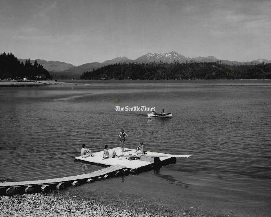 Vacationists relaxed and fished in a typical summer scene at Hood Canal, near Union, Mason County, popular vacation area for Washington residents and visitors to Washington. (Josef Scaylea / The Seattle Times, 1957)