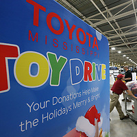 Toyota team members load up bags full of toys to help with the Salvation Army Angel Tree.