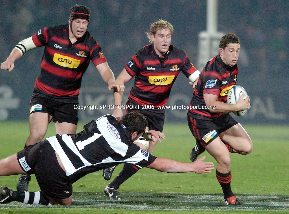 Canterbury's Cameron McIntyre beats the diving tackle of Hawkes Bay's Clint Newland during the Air New Zealand Cup week 1 rugby match between Hawke's Bay and Canterbury at Mclean Park, Napier on Friday 28 July 2006. Photo: John Cowpland/PHOTOSPORT<br /> <br /> <br /> <br /> <br /> <br /> 280706