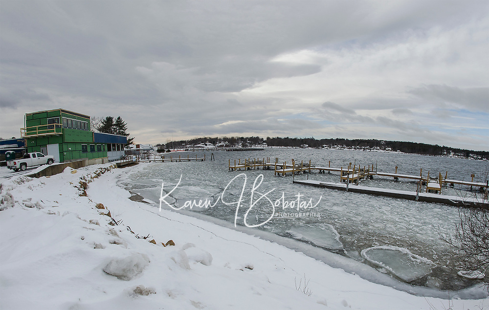 Frigid weather arrived Tuesday along with high winds combined with the warmer than normal temperatures are keeping the lake from freezing as seen from Watermark Construction on Paugus Bay.    (Karen Bobotas/for the Laconia Daily Sun)