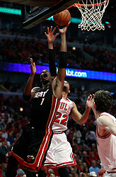 15.05.2011, UNITED CENTER, CHICAGO, USA, NBA, Chicago Bulls vs Miami Heat, im Bild Chris Bosh (L) shoots against Chicago Bulls forward Taj Gibson (C) in game 1 of the NBA Eastern Conference Championships at the United Center in Chicago, EXPA Pictures © 2011, PhotoCredit: EXPA/ Newspix/ KAMIL KRZACZYNSKI +++++ ATTENTION - FOR AUSTRIA/ AUT, SLOVENIA/ SLO, SERBIA/ SRB an CROATIA/ CRO, SWISS/ SUI and SWEDEN/ SWE CLIENT ONLY +++++