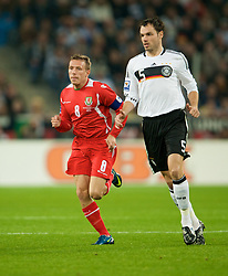 MONCHENGLADBACH, GERMANY - Wednesday, October 15, 2008: Wales' captain Craig Bellamy and Germany's Heiko Westermann during the 2010 FIFA World Cup South Africa Qualifying Group 4 match at the Borussia-Park Stadium. (Photo by David Rawcliffe/Propaganda)