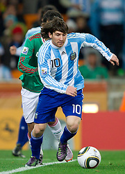 Lionel Messi of Argentina during the 2010 FIFA World Cup South Africa Round of Sixteen match between Argentina and Mexico at Soccer City Stadium on June 27, 2010 in Johannesburg, South Africa. (Photo by Vid Ponikvar / Sportida)