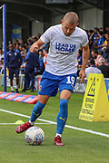 AFC Wimbledon attacker Shane McLoughlin (19) warming up during the EFL Sky Bet League 1 match between AFC Wimbledon and Wycombe Wanderers at the Cherry Red Records Stadium, Kingston, England on 31 August 2019.