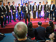 "19 JULY 2013 - BANGKOK, THAILAND:  REUBEN HENDLER, a  Yale senior cognitive studies major, fronts the Whiffenpoofs during their show in Bangkok Friday. The Yale Whiffenpoofs, one of the best-known collegiate a cappella groups in the world performed in CentralWorld in Bangkok Friday. Founded in 1909, the ""Whiffs"" began as a senior quartet that met for weekly concerts at Mory's Temple Bar, the famous Yale tavern. The Bangkok stop was a part of their 2013 world tour and was sponsored by the US Embassy. They sang at the opening of a photo exhibit that marked 180 years of friendly diplomatic relations between Thailand and the United States.    PHOTO BY JACK KURTZ"