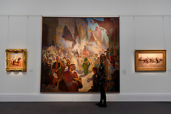 "© Licensed to London News Pictures. 21/04/2017. London, UK.  A staff member views (C) ""The Procession of the Mahmal through the Streets of Cairo"" by Ludwig Deutsch (est. GBP 250-350k), at a preview at Sotheby's, New Bond Street, of upcoming sales of Arts of the Islamic World, 20th century Middle East Art and Orientalist art. Photo credit : Stephen Chung/LNP"