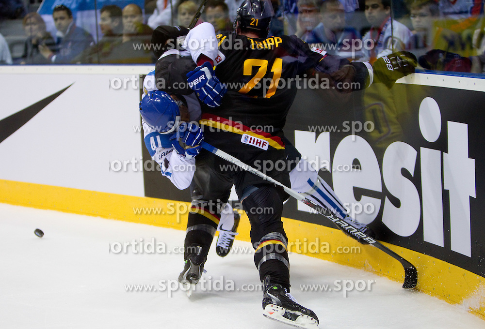 Pasi Puistola of Finland vs John Tripp of Germany during ice-hockey match between Germany and Finland of Group E in Qualifying Round of IIHF 2011 World Championship Slovakia, on May 6, 2011 in Orange Arena, Bratislava, Slovakia. Finland defeated Germany 5-4 after overtime and shootout. (Photo By Vid Ponikvar / Sportida.com)
