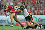 """Dom Shipperley sights the try line as he attempts to break the tackle of Michael Hooper late in the Super 15 Rugby Union match (Round 7) between the Queensland Reds and the ACT Brumbies played at Suncorp Stadium (Brisbane, Australia) on Good Friday 6th April 2012 ~ Queensland (20) defeated the Brumbies (13) ~ This image is intended for Editorial use only - Required Images Credit """"Steven Hight - Aura Images"""""""